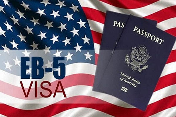 U.S. flag with the word EB-5 and two passports.