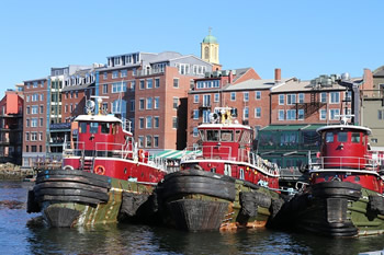 EB-5 Regional Center in New Hampshire. Photo of tug boats docked at shore of Portsmouth, New Hampshire.