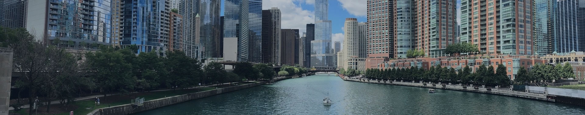 Photo of downtown Chicago and river flowing through it.